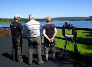 Volunteer with visitors at the Leaplish Watchpoint (c) Sally Hutt